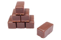 Stack of chocolate sweets on white background Stock Photos
