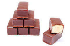 Stack of chocolate sweets on white background Royalty Free Stock Image
