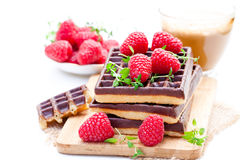 Stack of chocolate waffles with fresh raspberry and cup of coff. Stack  of chocolate waffles with fresh raspberry and cup of coffee Royalty Free Stock Photos