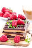 Stack of chocolate waffles with fresh raspberry and cup of coff. Stack  of chocolate waffles with fresh raspberry and cup of coffee Stock Photo