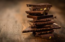 Stack chocolate on wooden table stock image