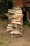 Stack chopped birch firewood pile high in profile on dry ground background stocking firewood winter fireplace stock photo