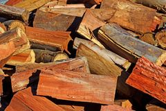 Blue gum fire wood pile. Stack of chopped Eucalyptus blue gum fire wood royalty free stock photo
