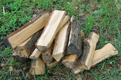 Stack of chopped firewood on natural green background close Royalty Free Stock Photos