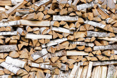 Stack of chopped firewood prepared for winter Stock Photo