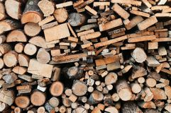Stack of chopped firewoods prepared for winter. Wooden background Royalty Free Stock Photography