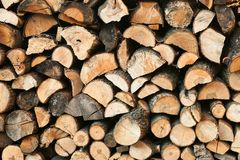 Stack of chopped firewoods prepared for winter Stock Photos