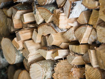 Stack of chopped wooden logs Royalty Free Stock Photos