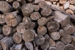 Stack of chopped woodfire closeup. Trunk concept. Cracked logs texture. Old cut firewood. Royalty Free Stock Photography