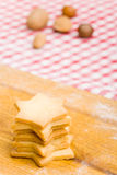 Stack of christmas cookies and nuts Royalty Free Stock Images