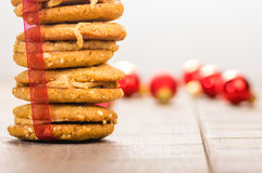 Stack of Christmas Cookies tied with red ribbon Royalty Free Stock Photos
