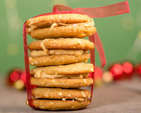 Stack of Christmas Cookies tied with red ribbon Stock Photo