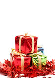 Stack of Christmas gifts. Stack of Christmas gift boxes and red tinsel Royalty Free Stock Photography