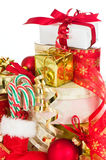 Stack Of Christmas Presents. With stocking filled with candy canes Stock Image