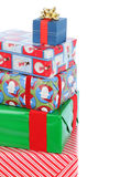 Stack of Christmas Presents. Close up of stack of five wrapped Christmas presents of varying sizes and shapes. Verticla format with copy space at the top and royalty free stock photo