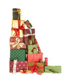 Stack of christmas presents. High up stack of christmas presents with beautiful decorative bows and feathers Royalty Free Stock Image