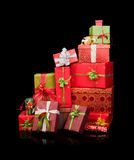 Stack of christmas presents. Beautiful stack of christmas presents with ribbons and bows royalty free stock photography