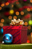 Stack of Christmas presents. Stack of Christmas gift boxes under a tree with defocused lights royalty free stock photography