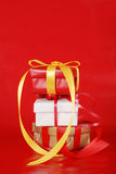 Stack of christmas presents on red. Closeup of Stack of christmas presents on red Royalty Free Stock Photos