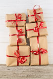 Stack of Christmas presents on a table. Stack of Christmas presents on a wooden table stock photos