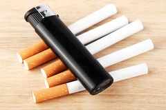 Stack of cigarette with the lighter Royalty Free Stock Photos
