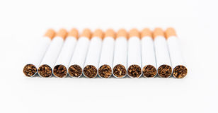 Stack of cigarette on the white background with partial focus Stock Photos