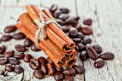 Stack of cinnamon sticks and coffee beans Royalty Free Stock Photography