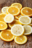Stack of citrus fruits slices. Oranges and lemons. Stock Photo