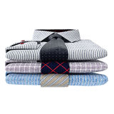 Stack of classic men's shirts and ties, front view Stock Photo