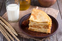 Stack of crepes or pancakes for Maslenitsa. Stack of classic Russian thin pancakes bliny or crepes with honey on a plate. Traditional for the Russian pancake royalty free stock photos