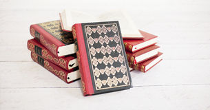 Stack of classical books. Picture of a stack of classic books, on a wooden white floor Royalty Free Stock Photography