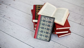 Stack of classical books. Picture of a stack of classic books, on a wooden white floor Royalty Free Stock Photos