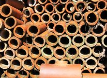 A Stack of Clay Drainage Pipes Royalty Free Stock Photo