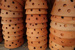 Stack of clay flower pots Stock Photo