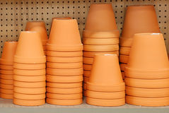 Stack of clay pots on a shelf Royalty Free Stock Image