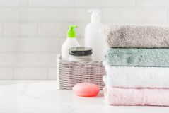 Stack clean bath towels. Spa relax and bath concept, sea salt, soap, with cosmetics and towels in bathroom white background, copy space top view Royalty Free Stock Image