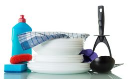 Stack of clean dishes, bottle of detergent, sponge and towel isolated on white. Background Stock Images