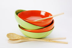 Stack of clean empty plates and wooden spoons  on white backgrou Stock Images