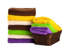 Stack of clean fresh towels isolated Stock Images
