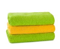 Stack of clean fresh towels isolated Stock Image