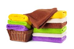 Stack of clean fresh towels isolated Stock Photography
