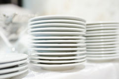 Stack of clean plates ready to be used on dinner Stock Images
