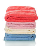 Stack of clean towels ironing isolated on white background. Royalty Free Stock Images