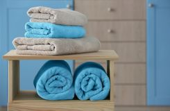 Stack of clean towels on shelves. Indoors Stock Photography