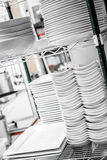 Stack of Cleaned Dishes in a Restaurant Royalty Free Stock Photo
