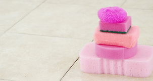 Stack of cleaning sponges. On floor stock footage