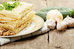Stack of closed pizza and vegetables Royalty Free Stock Images