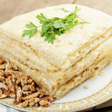 Stack of closed pizza with walnuts Stock Image