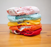 Stack of cloth diapers on a wooden table Royalty Free Stock Photos