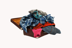Stack of clothes in opened suitcase isolated on white background Royalty Free Stock Photo